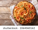 spicy spaghetti with shrimps in ... | Shutterstock . vector #1064060162