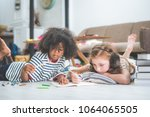little cute girls studying and... | Shutterstock . vector #1064065505