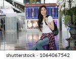 pretty young female passenger... | Shutterstock . vector #1064067542