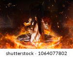 Woman sitting in burning...