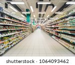 abstract blurred supermarket... | Shutterstock . vector #1064093462