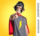 superhero monkey man pointing... | Shutterstock . vector #1064094452