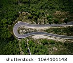 aerial view from drone of curve ... | Shutterstock . vector #1064101148