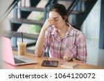 stressed freelancer woman... | Shutterstock . vector #1064120072