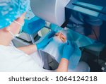 laser vision correction. a... | Shutterstock . vector #1064124218