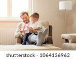 little boy giving gift box to... | Shutterstock . vector #1064136962