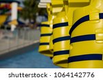 yellow life jackets    Shutterstock . vector #1064142776