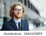young smiling bearded...   Shutterstock . vector #1064153855