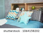 many different soft pillows on... | Shutterstock . vector #1064158202