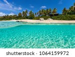 beautiful tropical beach with... | Shutterstock . vector #1064159972