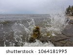 wave of water splash over the rocky shore and inukshuk at the hecla provincial park in manitoba