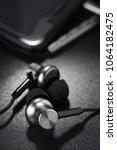 metallic ear buds or earphones... | Shutterstock . vector #1064182475