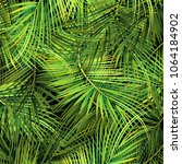 green palm tree branches on... | Shutterstock .eps vector #1064184902