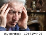 senior man with headache | Shutterstock . vector #1064194406