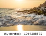 sunset at playa mermejita  on... | Shutterstock . vector #1064208572