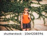 funny little girl traveler... | Shutterstock . vector #1064208596