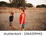 cute little kids enjoying... | Shutterstock . vector #1064209442