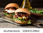 burger with bacon and pate on a ... | Shutterstock . vector #1064212862