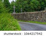 stone christian cross... | Shutterstock . vector #1064217542