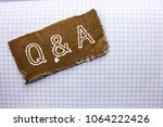 Small photo of Text sign showing Q A. Conceptual photo Ask Frequently Faq Asked Question Help Solving Doubt Query Support written on tear Cardboard Piece on the Check background.