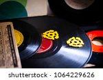 vinyl records and adaptors   Shutterstock . vector #1064229626