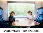 child traveling by train.... | Shutterstock . vector #1064230088