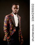 Small photo of closeup photo of handsome African fashion model in a unusual glam suit. the in thing.all the rage. concept of fashion