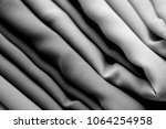 stack of clothes   a textile is ... | Shutterstock . vector #1064254958