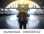 young traveler walking with... | Shutterstock . vector #1064265212