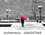 Woman with red umbrella walking ...