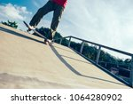 skateboarder legs riding... | Shutterstock . vector #1064280902