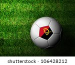 Angola Flag Pattern 3d rendering of a soccer ball in green grass - stock photo