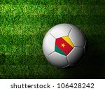 Cameroon Flag Pattern 3d rendering of a soccer ball in green grass - stock photo