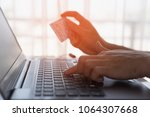 man holding credit card close... | Shutterstock . vector #1064307668