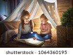 two cute little children are... | Shutterstock . vector #1064360195