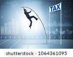 businessman jumping over tax in ... | Shutterstock . vector #1064361095