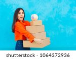 woman with many cardboard boxes ... | Shutterstock . vector #1064372936