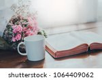 holy bible with a cup of coffee ... | Shutterstock . vector #1064409062