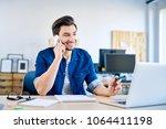smiling young web developer...   Shutterstock . vector #1064411198