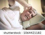 senior man with pain in hand.... | Shutterstock . vector #1064421182