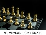 the gold and silver chess on... | Shutterstock . vector #1064433512