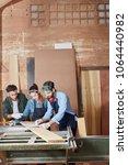 carpenters team working as part ... | Shutterstock . vector #1064440982