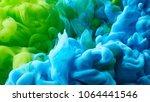 ink drop in water background | Shutterstock . vector #1064441546