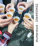 people hold drinks and... | Shutterstock . vector #1064453432