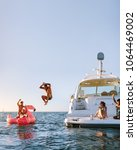 young man jumping off the boat... | Shutterstock . vector #1064469002