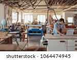 skilled young craftsman... | Shutterstock . vector #1064474945