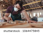 young craftsman wearing a...   Shutterstock . vector #1064475845