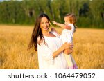 mom and daughter walking in the ... | Shutterstock . vector #1064479052