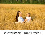 mom and daughter walking in the ... | Shutterstock . vector #1064479058
