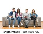 the four friends with phones... | Shutterstock . vector #1064501732